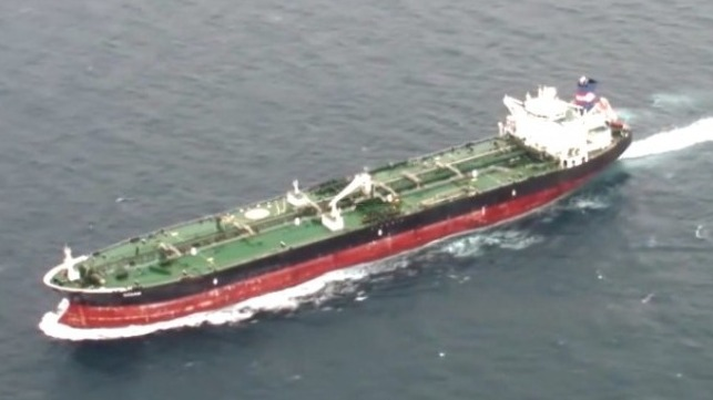 Tanker Saves Two People Clinging to Board in the Ocean